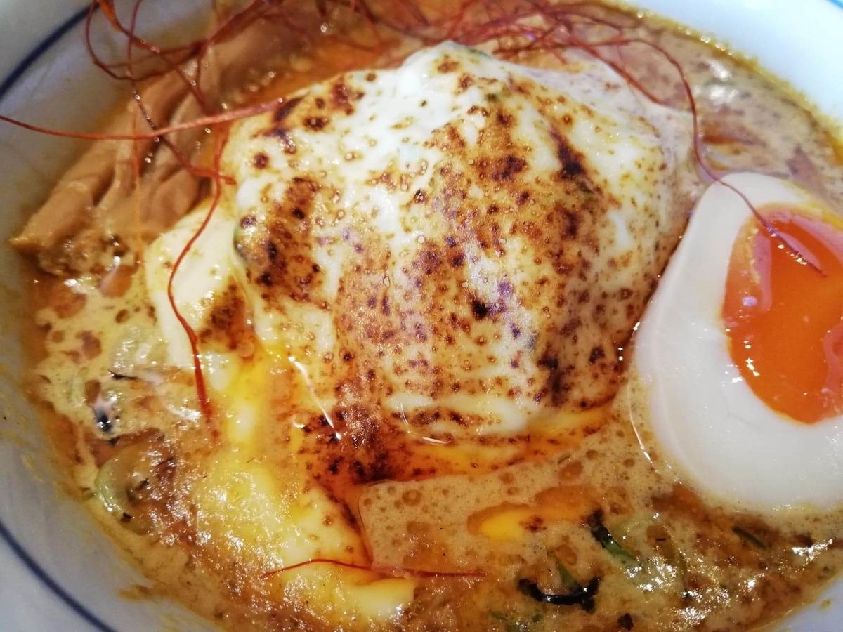 高田馬場『つけ蕎麦安土』の、カレーチーズの写真