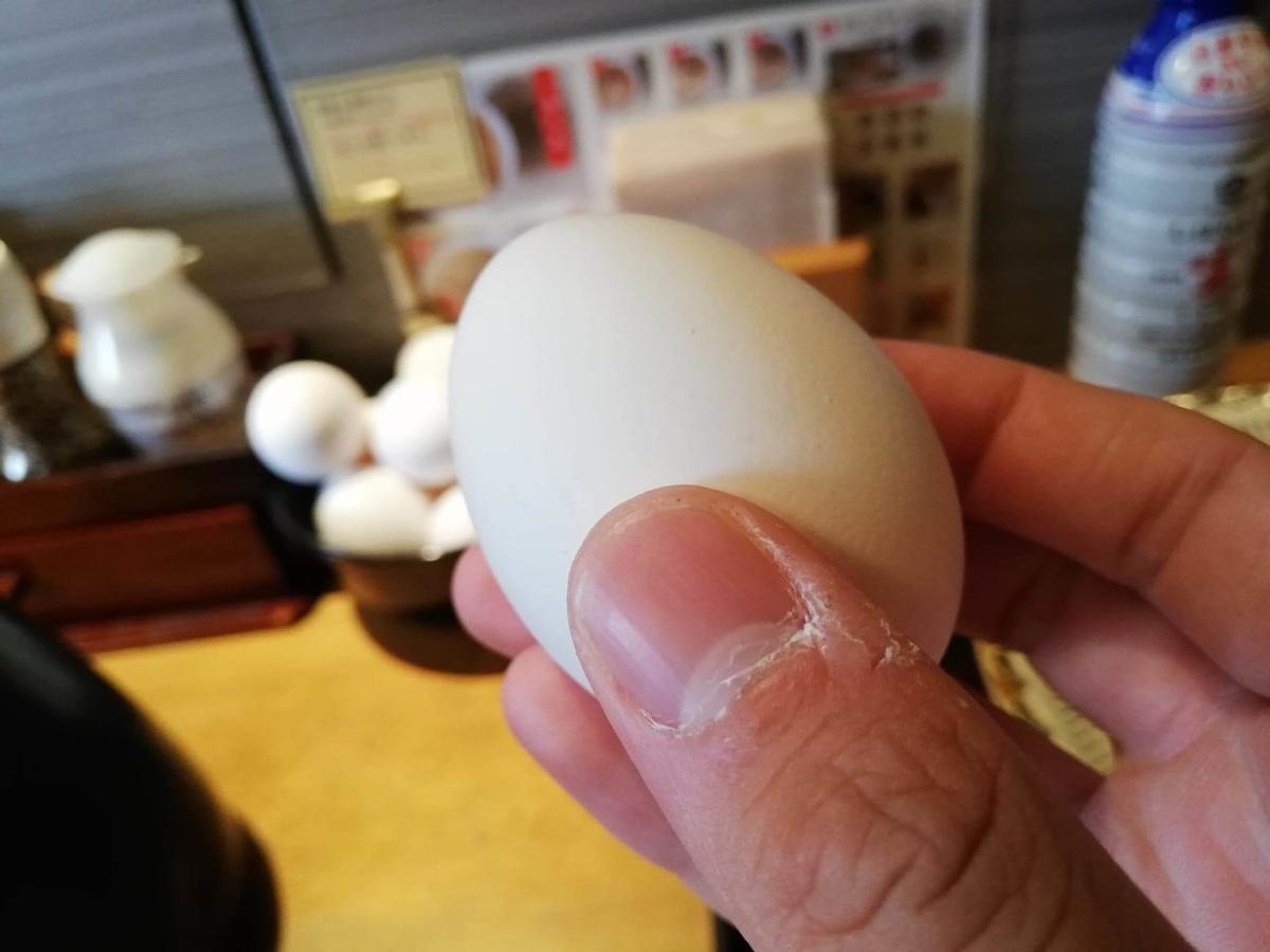 高田馬場『つけ蕎麦安土』の生卵の写真